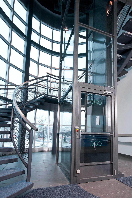 Glass Vertical Wheelchair Lift - Elevators